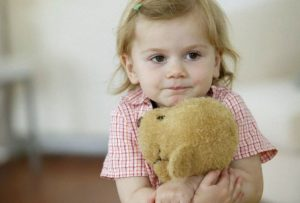 Girl hugging teddy